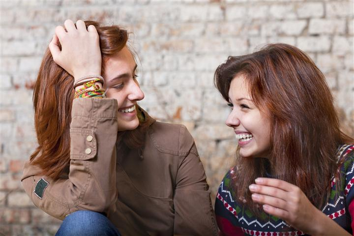 6b3aedec9a Two young women laughing – Women s Wellness Comprehensive Care
